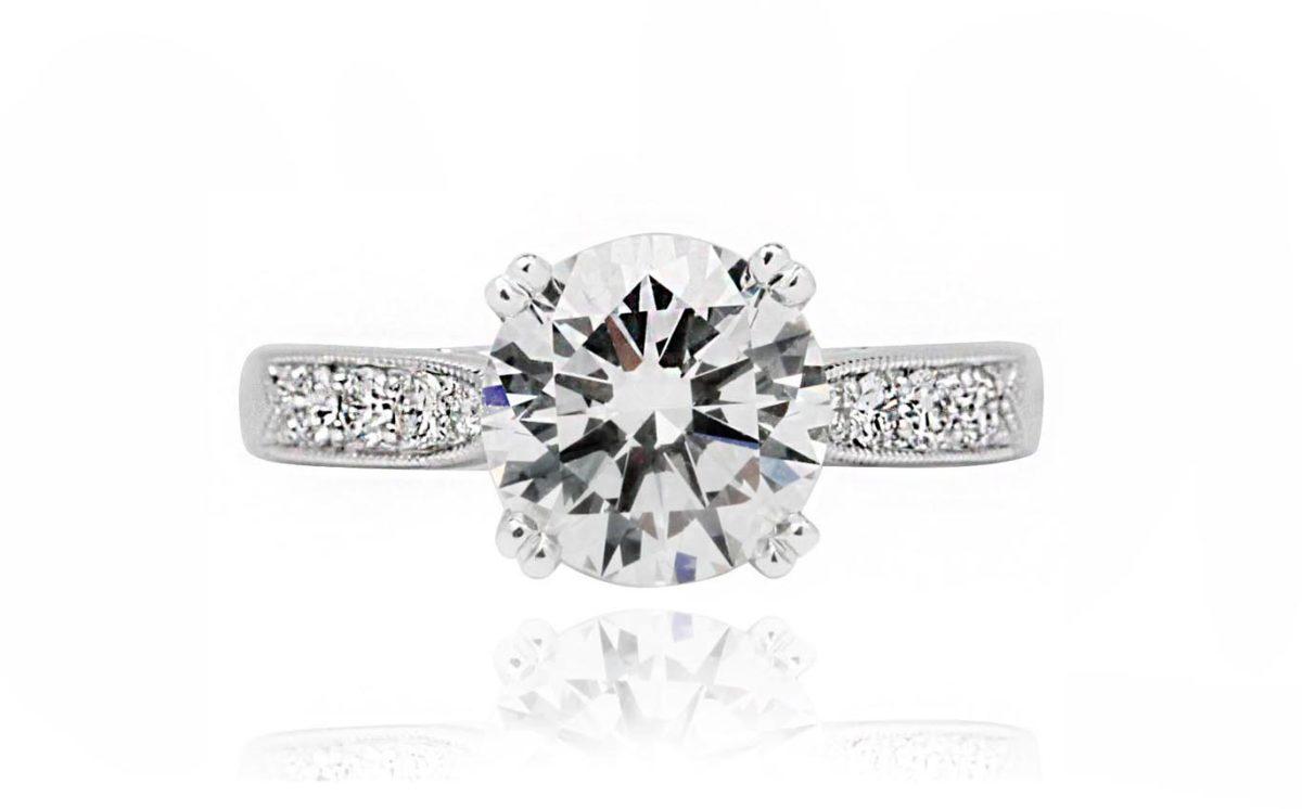 Round brilliant cut 18CT gold diamond engagement ring