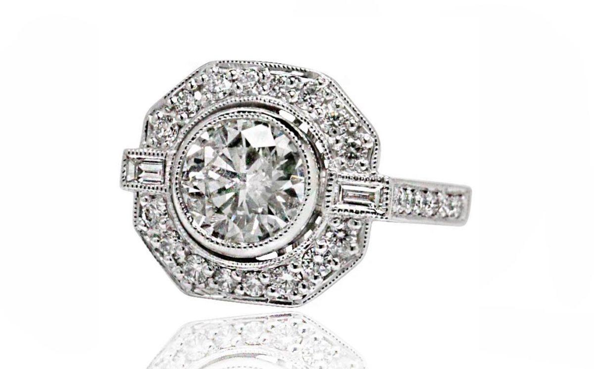 18ct White Gold Round Brilliant cut diamond halo engagement ring