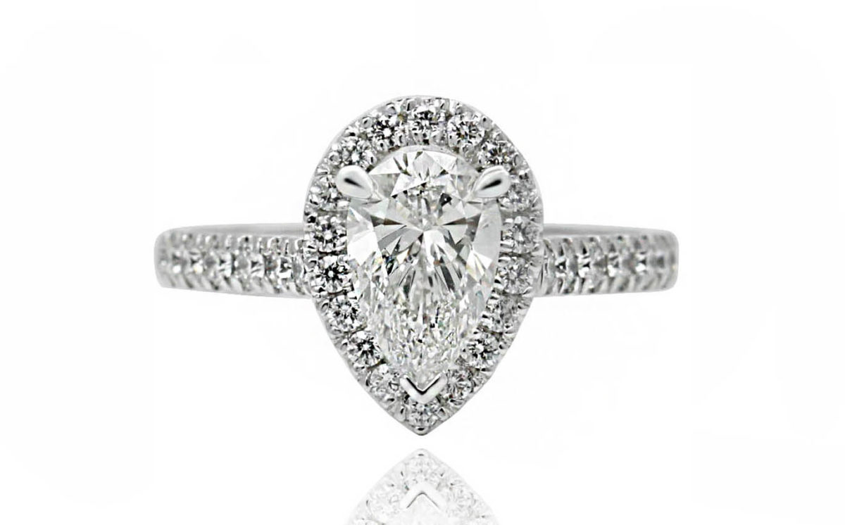 Pear shape engagement ring with diamonds and white gold